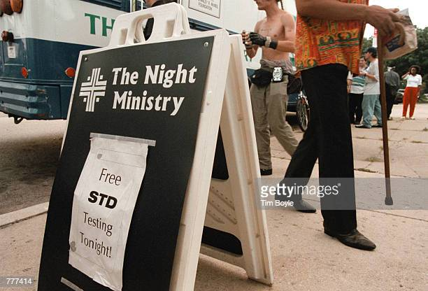 A sign is posted outside The Night Ministry bus August 9 2000 in the Uptown neighborhood of Chicago informing street citizens of the free STD testing...