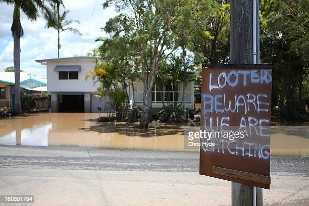 A sign is put up in East Bundaberg after reports of looters as parts of southern Queensland experiences record flooding in the wake of Tropical...