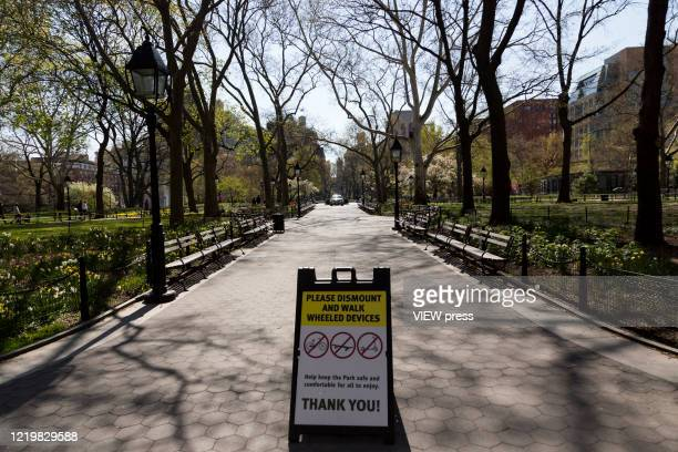 """Sign is seen across Washington Square Park on April 19, 2020 in New York City. NY Governor Andrew Cuomo announced this week that the """"New York Pause..."""