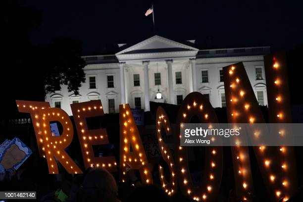 A 'TREASON' sign is seen as activists participate in a vigil in front of the White House July 18 2018 in Washington DC Public Citizen held a...