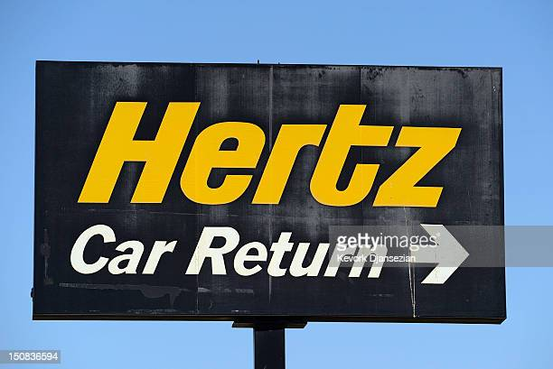 A sign is seen at a Hertz Global Holdings car rental branch August 27 2012 in Los Angeles California Two major rental car companies agreed to merge...