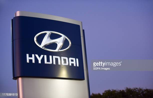 A sign is seen at a Hyundai car dealership Hyundai and Kia announced on October 11 2019 that they have agreed to settle a class action lawsuit over...