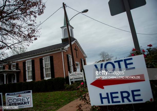 A sign is seen at a polling station during the midterm elections at the Aldie Methodist church in Aldie Virginia on November 6 2018 Americans started...