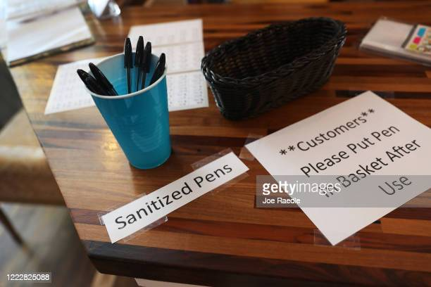 Sign is seen at a store, as the state of Florida enters phase one of the plan to reopen the state on May 04, 2020 in Stuart, Florida. Restaurants,...