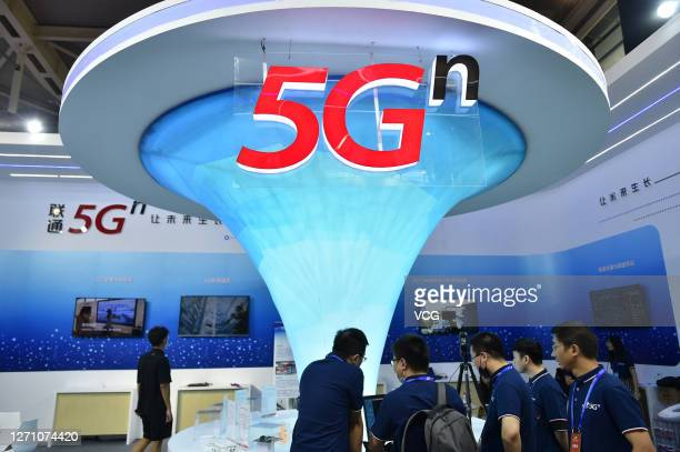 Sign is seen at China Unicom booth during the 16th China International Software Product and Information Service Trade Fair at the Nanjing...