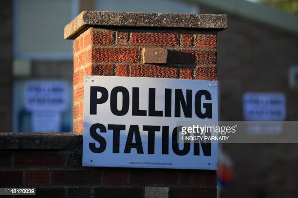 Sign is seen at The Christ the Carpenter church Hall polling station in Peterborough, England on June 6, 2019. - A local by-election was triggered...