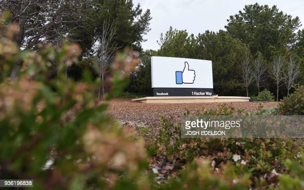 A sign is seen at the entrance to Facebook's corporate headquarters location in Menlo Park California on March 21 2018 Facebook chief Mark Zuckerberg...