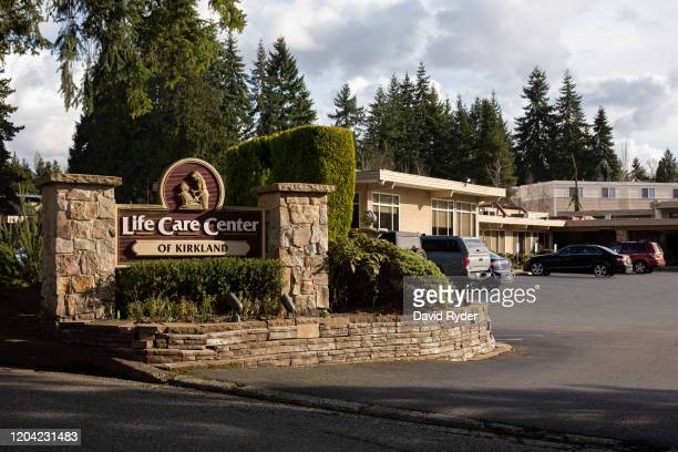 A sign is seen at the entrance to Life Care Center of Kirkland on February 29 2020 in Kirkland Washington Dozens of staff and residents at Life Care...