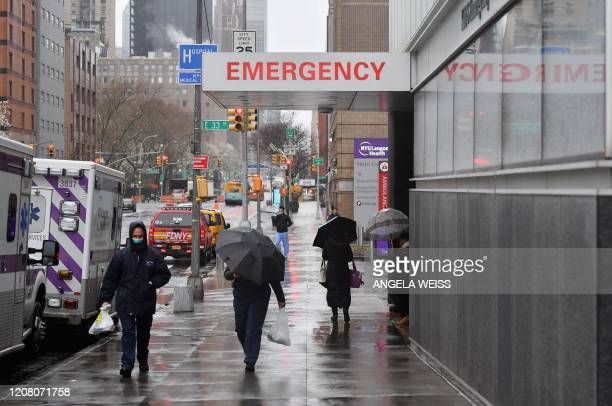 A sign is seen at the NYU Langone Health Center hospital emergency room entrance on March 23 2020 in New York City Anxiety ratcheted up across New...