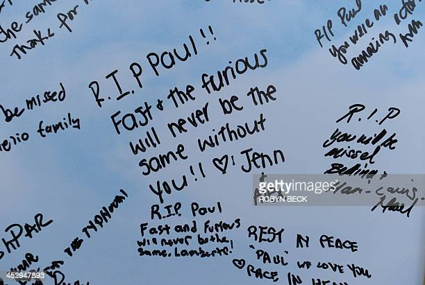 A sign is seen at the site of the car accident in which actor Paul Walker was killed in Santa Clarita California on December 1 2013 Fans and fellow...