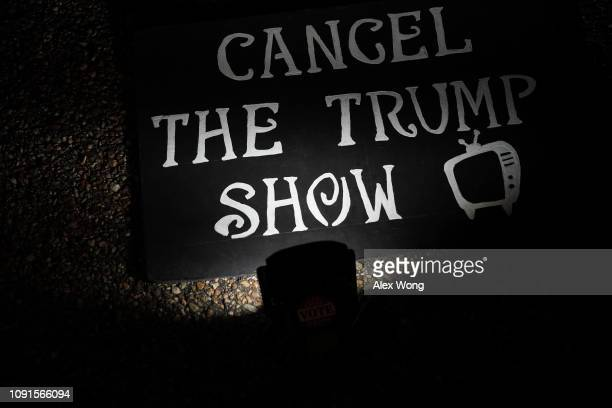 A sign is seen during a protest outside the White House in response to US President Donald Trump's prime time address to the nation January 8 2019 in...