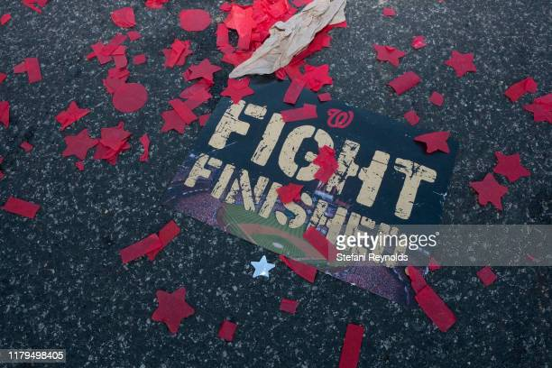 A sign is seen in confetti following the Washington Nationals parade that celebrated their World Series victory over the Houston Astros on November 2...