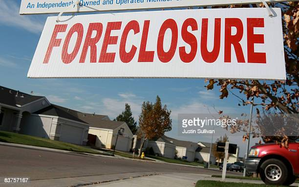 A sign is seen in front of a foreclosed home November 19 2008 in Rio Vista California The Northern California city of Rio Vista is considering plans...