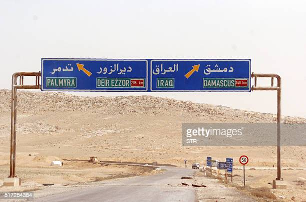 A sign is seen indicating a road leading to the ancient Syrian city of Palmyra on March 24 2016 Backed by Russian warplanes and allied militia on the...