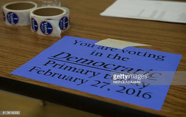 A sign is seen inside a polling station during the South Carolina Democratic primary vote in Columbia South Carolina on February 27 2016 Hillary...