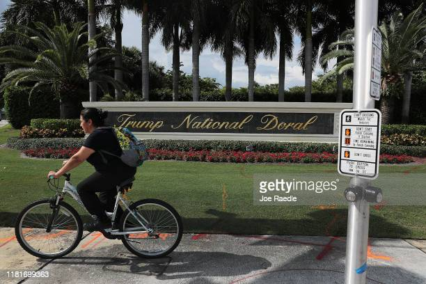 A sign is seen near an entrance to the Trump National Doral golf resort owned by US President Donald Trump's company on October 17 2019 in Doral...