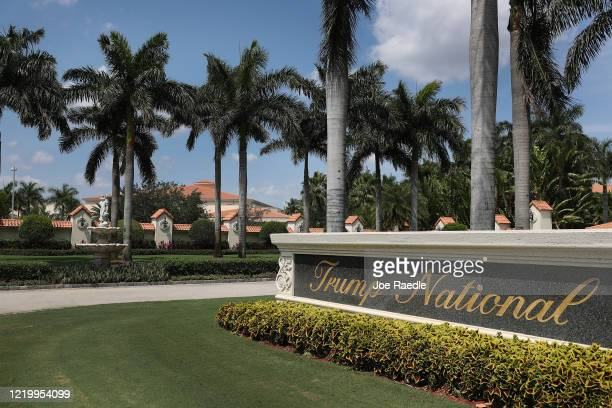 A sign is seen near the entrance to the Trump National Doral golf resort on April 20 2020 in Doral Florida Reports indicate that Trump properties...