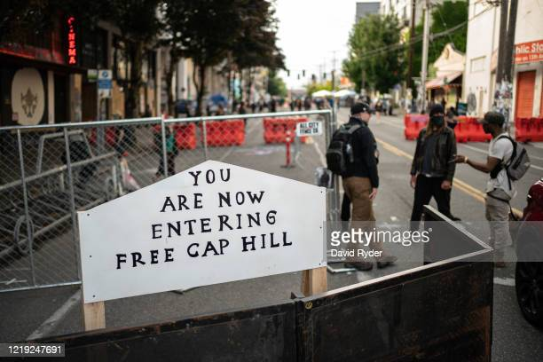 A sign is seen on a barrier at an entrance to the socalled Capitol Hill Autonomous Zone on June 10 2020 in Seattle Washington The zone includes the...