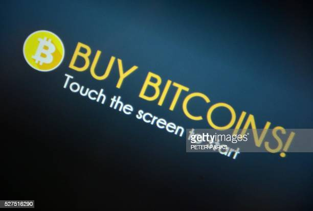 A sign is seen on a Bitcoin machine in Sydney on May 3 2016 Secretive Australian entrepreneur Craig Wright who has revealed himself as the creator of...