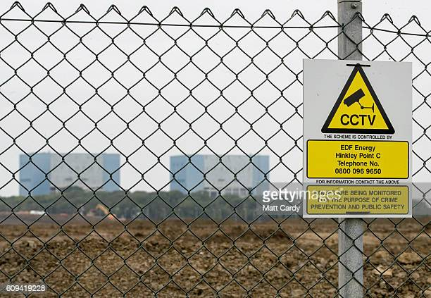A sign is seen on a fence close to the Hinkley Point A buildings near Bridgwater on September 20 2016 in Somerset England The decision last week by...
