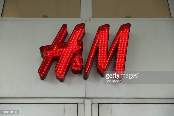 A sign is seen on a HM clothing store on January 9 2018 in Miami Beach Florida HM apologized on Monday after the Swedish clothing retailer's website...