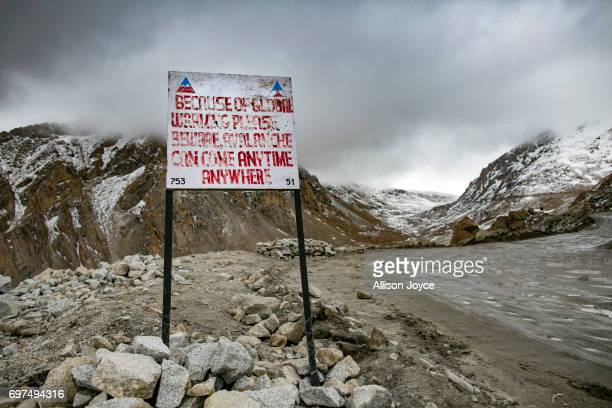 A sign is seen on a mountain road which reads because of global warming please beware avalanche can come anytime anywhere on June 14 2017 in Ladakh...