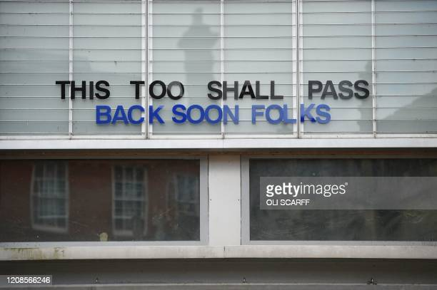 A sign is seen on the front of a closed cinema in York northern England on March 30 as life in Britain continues during the nationwide lockdown to...