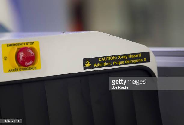A sign is seen on the Transportation Security Administration new 3D scanner at the Miami International Airport on May 21 2019 in Miami Florida TSA...