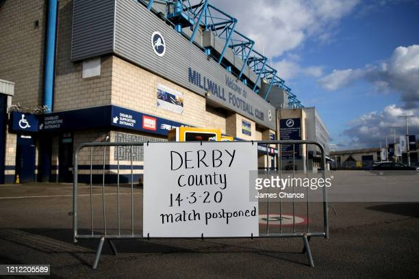 Sign is seen outisde The Den stating that the Sky Bet Championship match between Millwall FC and Derby County will be postponed at The Den on March...