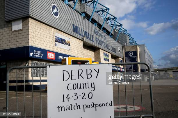 A sign is seen outisde The Den stating that the Sky Bet Championship match between Millwall FC and Derby County will be postponed at The Den on March...