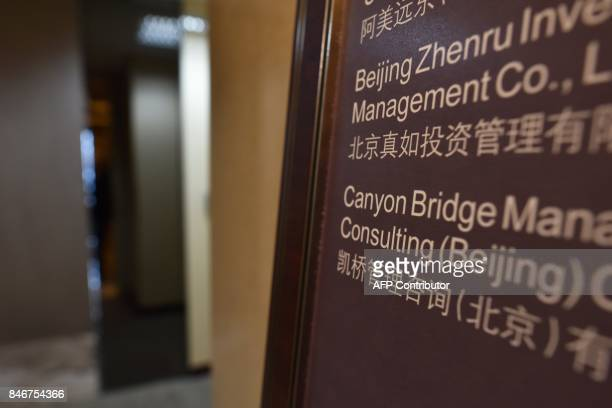 A sign is seen outside a Canyon Bridge office in Beijing on September 14 2017 US President Donald Trump on September 13 blocked attempts by a Chinese...