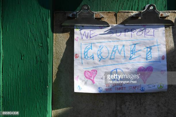 A sign is seen outside Comet Ping Pong on Monday Decmmber 05 2016 in Washington DC A man identified as Edgar Maddison Welch was arrested Sunday after...