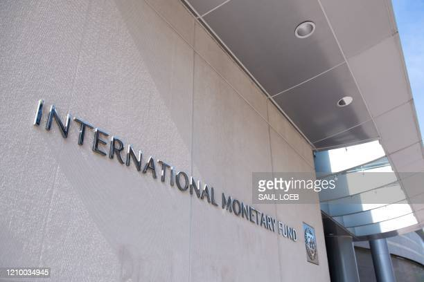 Sign is seen outside the headquarters of the International Monetary Fund as the IMF and World Bank hold their Spring Meetings virtually due to the...