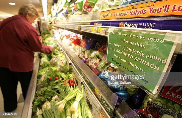 A sign is seen posted in the produce section of United Market alerting customers that all bagged fresh spinach has voluntarily been removed from...