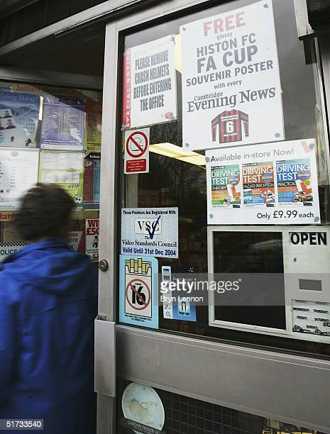 A sign is seen promoting the offer of a free Histon FC FA Cup poster with every copy of The Cambride Evening News prior to the FA Cup match between...