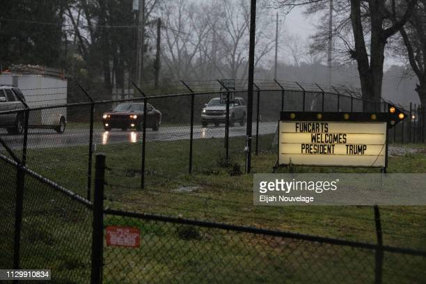 A sign is seen welcoming US President Donald Trump following an EF4 tornado on March 11 2019 in Opelika Alabama Numerous tornado touchdowns were...