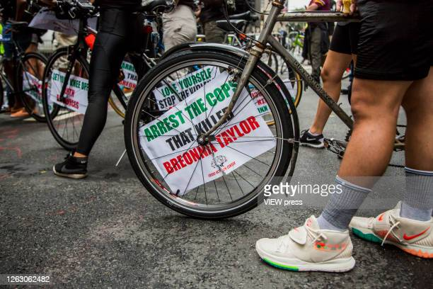 A sign is set on a bicycle duing a march next to the Trump Tower on 5 Av on July 31 2020 in New York City Since the murder of George Floyd by a...