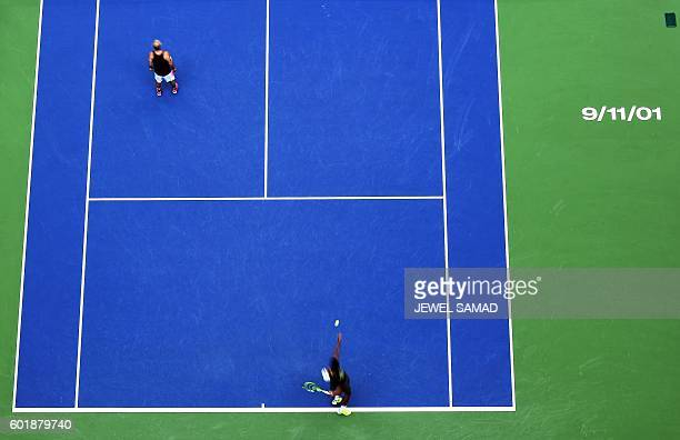 A 9/11/01 sign is stenciled on the Arthur Ashe Stadium court in remembrance of the victims and heroes of 9/11 attacks before the start of the 2016 US...