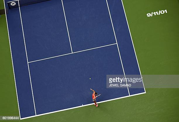A 9/11/01 sign is stenciled on the Arthur Ashe Stadium court in remembrance of the 9/11 attacks of 2001 as Angelique Kerber of Germany serves against...