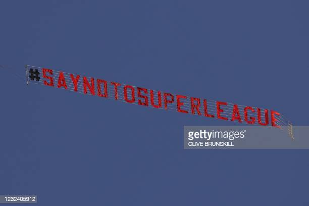 Sign is trailed by a plane with a slogan against a proposed new European Super League over the stadium during the warm up for the English Premier...