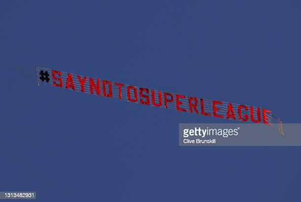 Sign is trailed by a plane with a slogan against a proposed new European Super League over the stadium during the warm up for the Premier League...