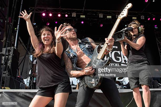 Sign language interpreter Holly Maniatty and J Bowman of Michael Franti Spearhead perform on April 17 2016 in Fort Lauderdale Florida