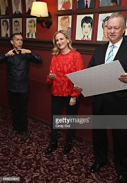 Sign language interpreter Jack Jason actress Marlee Matlin and Sardi's owner Max Klimavicius attend the Marlee Matlin Sardi's portait unveiling at...