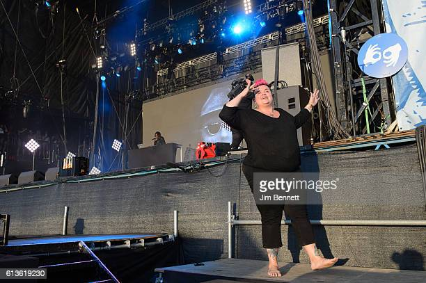 A sign language interpreter signs during Schoolboy Q's performance at Austin City Limits at Zilker Park on October 8 2016 in Austin Texas