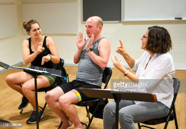 Sign language interpreters Mandy Welly Michael Creason and Christina WhitehouseSuggs act out their parts during a rehearsal for the musical Dear Evan...