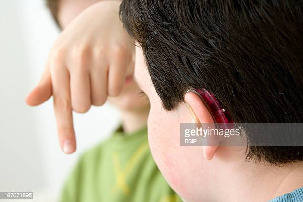 Sign language Models Do not use for HIV A young boy and his brother using the French sign language to discuss with his hearingimpaired brother The...