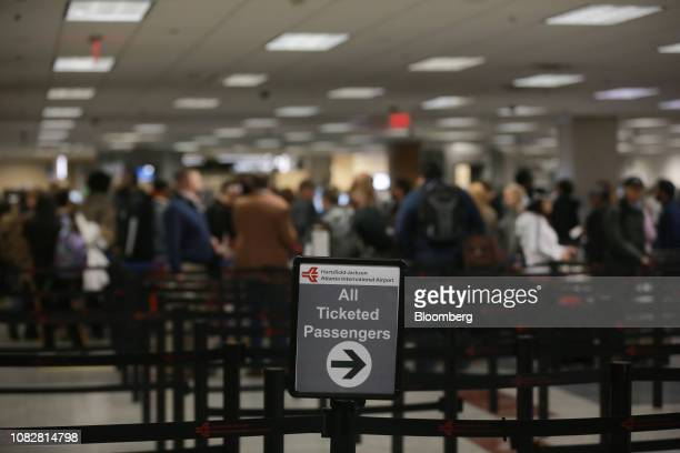 A sign leads travelers to a Transportation Security Administration checkpoint at HartsfieldJackson Atlanta International Airport in Atlanta Georgia...