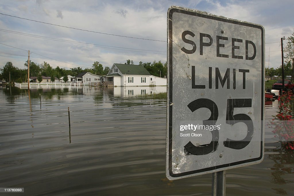 A sign lets drivers know the speed limit on a street flooded by the Ohio River May 5, 2011 in Paducah, Kentucky. Heavy rains have left the ground saturated, rivers swollen, and have caused widespread flooding in Missouri, Illinois, Kentucky, Tennessee, and Arkansas.