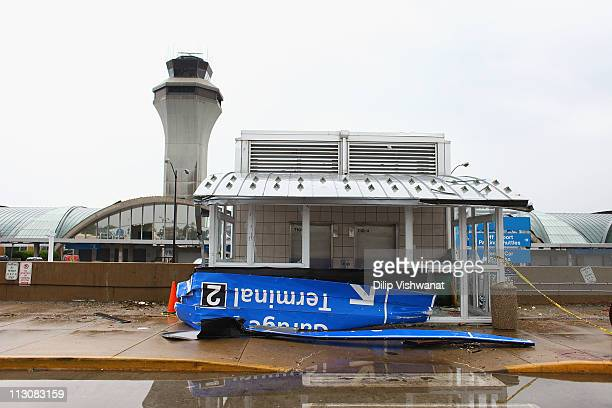 A sign lies in front of a stormdamaged shelter in a parking garage at LambertSt Louis International Airport April 23 2011 in St Louis Missouri The...