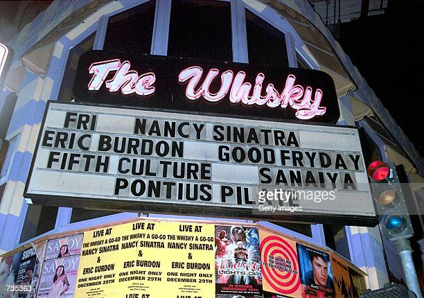 Sign lights up the street outside The Whiskey A Go-Go where singer Eric Burdon of The Animals and singer Nancy Sinatra performed December 29, 2000 in...